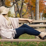 Freebird boots and Paige Denim paired with a floppy hat and neutral fringe poncho