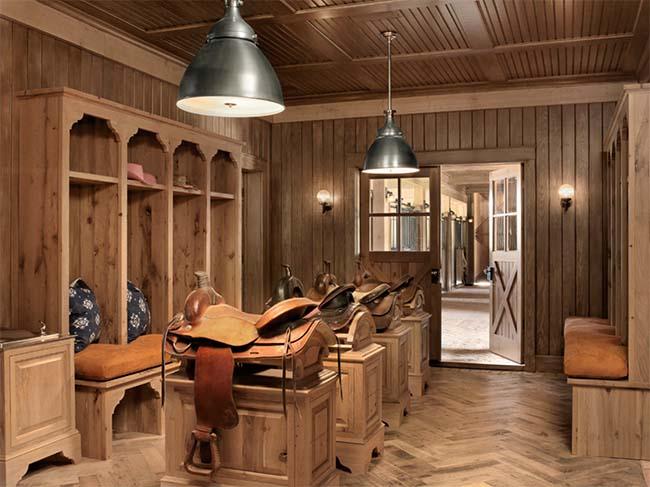 Tack room with mounted saddle racks