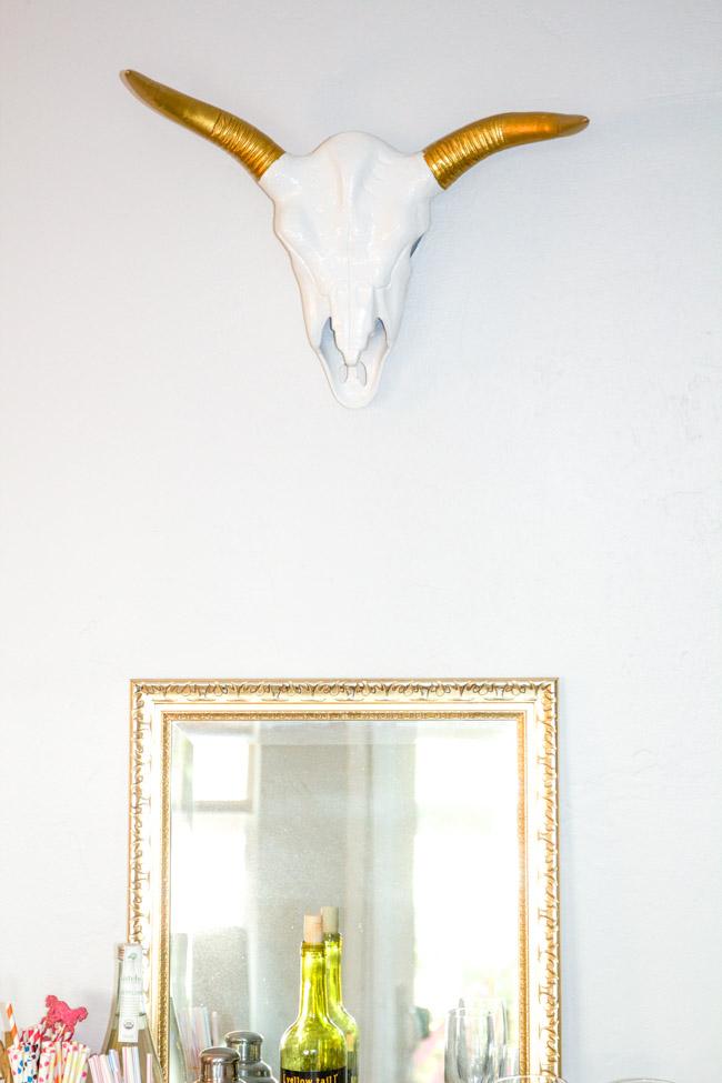 Ceramic Cow Skull Hanging Above The Bar Cart