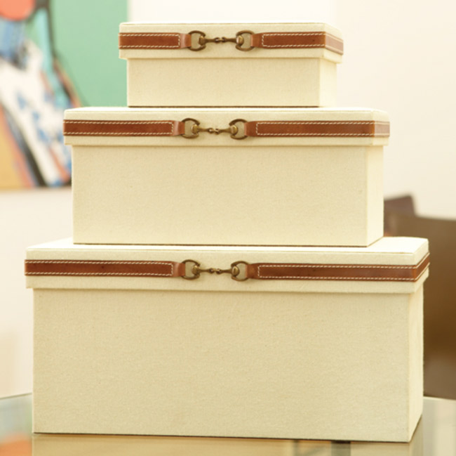 Decorative stack of equestrian snaffle bit boxes