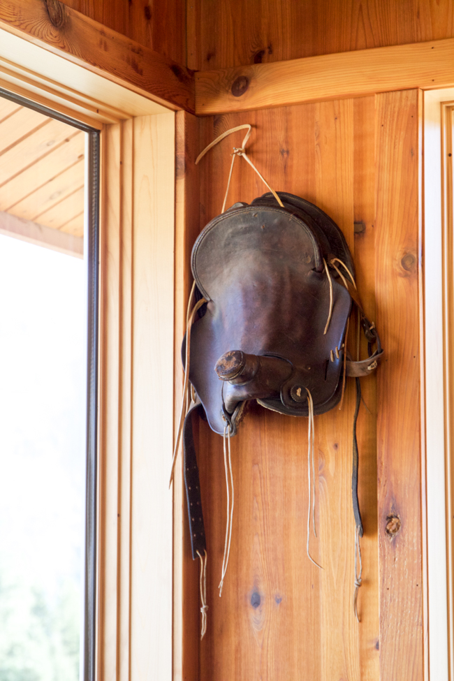 An Old Western Saddle Hanging On The Wall